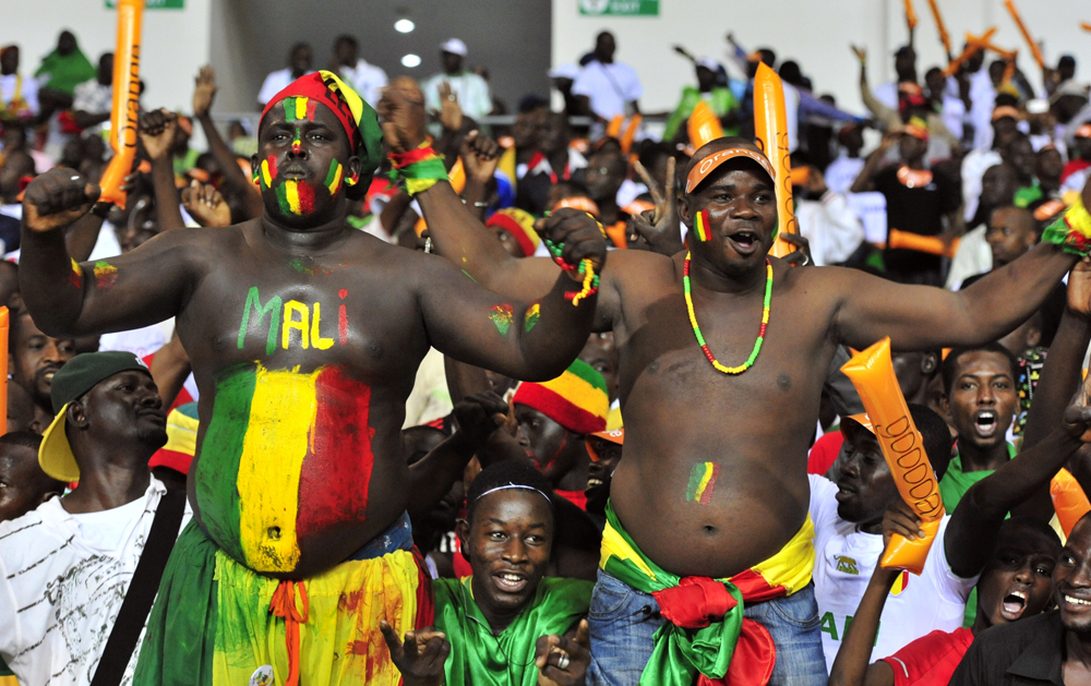 Supporters of the Malian national football team cheer up their team at the Stade de l'Amitie in Libreville on February 8, 2012 during their Africa Cup of Nations (CAN 2012) semi-final football match between Ivory Coast and Mali.     AFP PHOTO/ ISSOUF SANOGO (Photo credit should read ISSOUF SANOGO/AFP/Getty Images)
