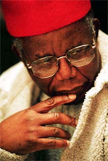 """Famed Nigerian writer and author of """"Things Fall Apart"""" Chinua Achebe pauses as he listens to well wisher's during a 2 day conference and celebration of his 70 birthday a Bard College.  Friday November 3, 2000.(Will Waldron Photo)"""